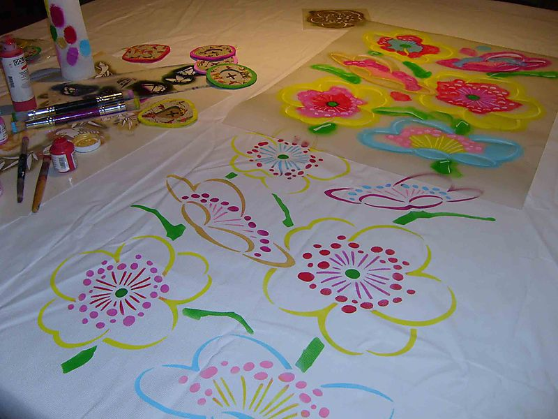 Stencilling JA blossom on cloth 61