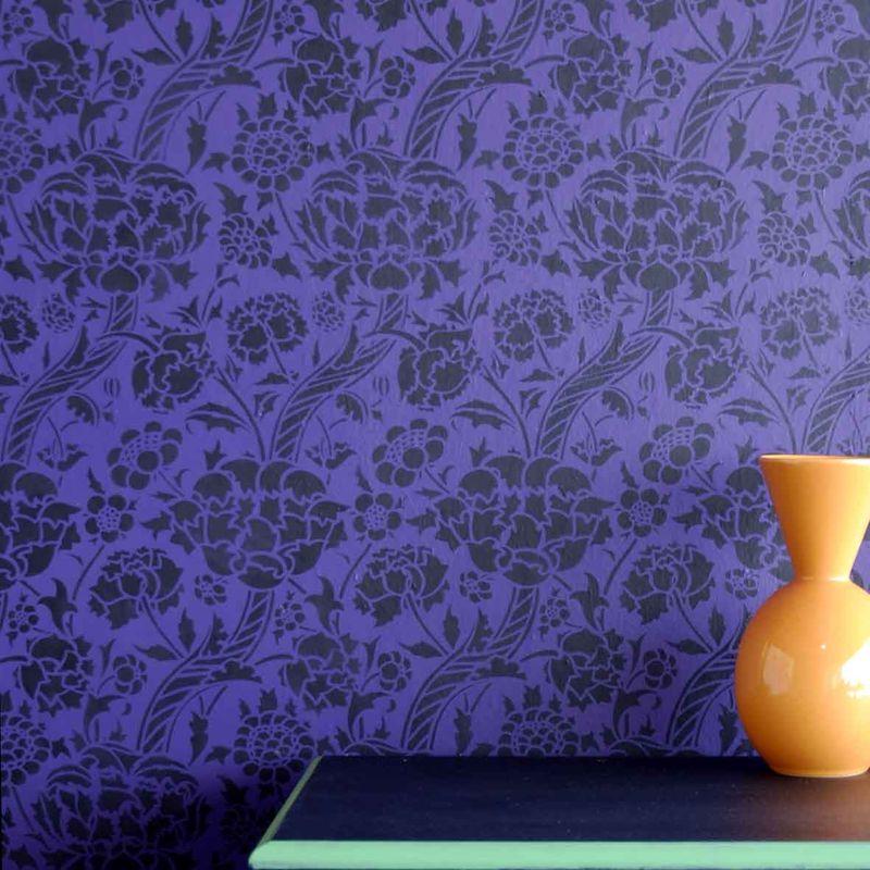 3 black DE82 stencil on purple wall-1