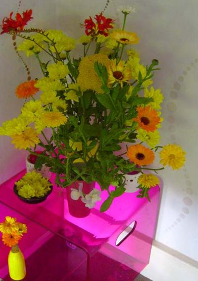 Yellow flowers pink table