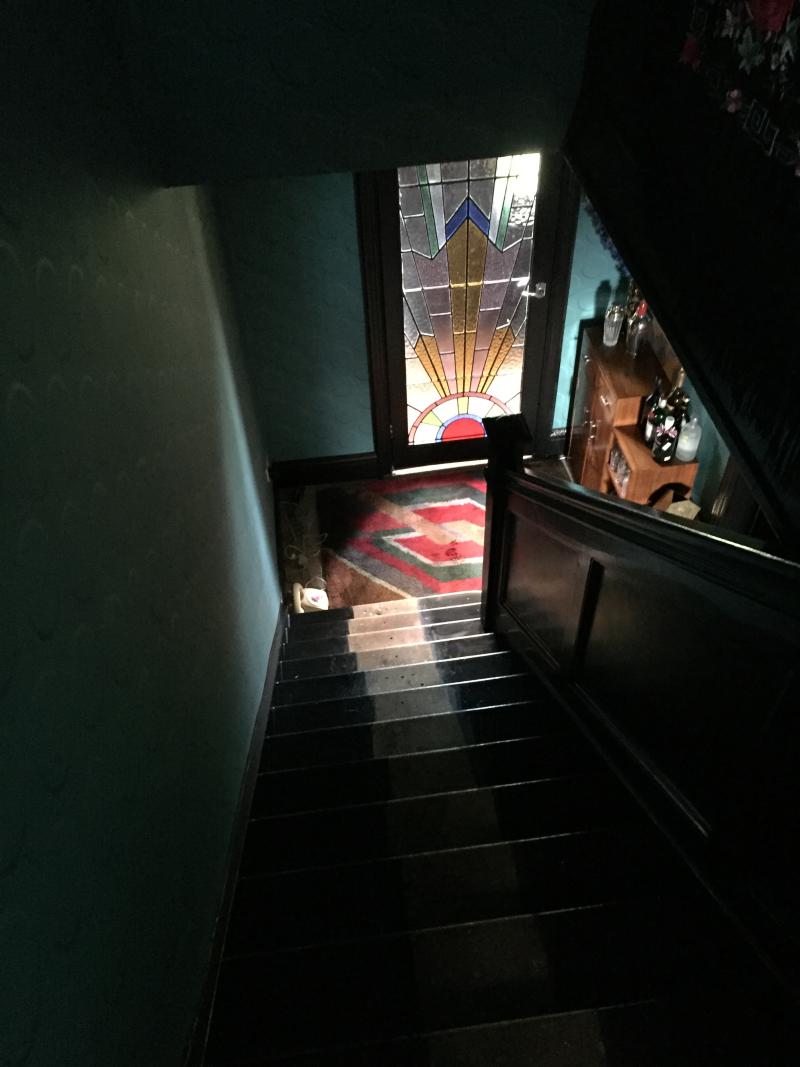 Stencilled hallway with black wood trim