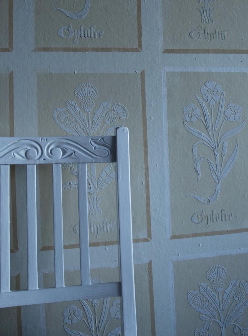 Tudor flowers stencil in plaster